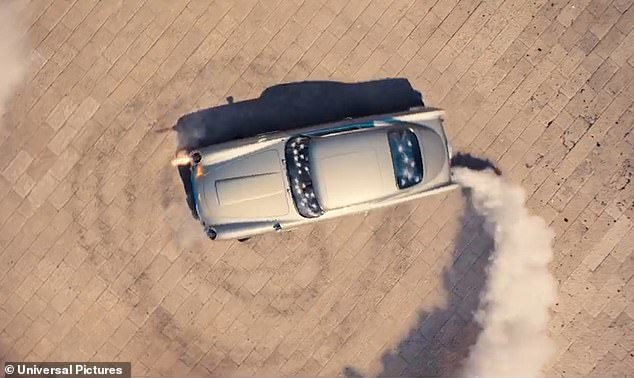Nail biting: At one point in the trailer, Bond spins around in his famous Aston Martin that's riddled with bullet holes