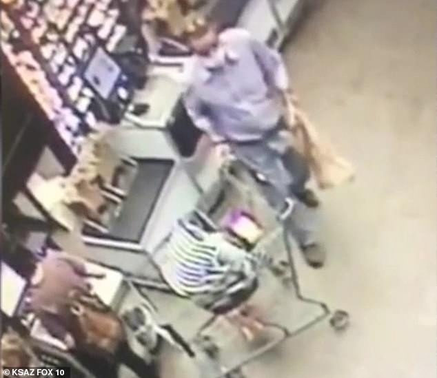 The man is seen above just before grabbing the cart as the mother (bottom left) pays for her items