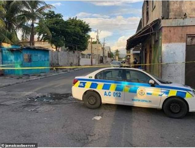 Former premier league footballer Jermaine Johnson was shot and wounded in a drive-by attack on Thursday evening in Kingston, Jamaica, pictured. Police at the scene believe the attack may be in connection with a local gangland feud