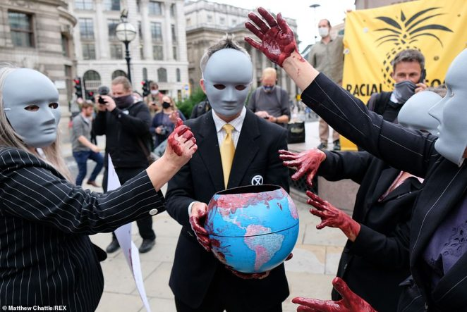 Demonstrations continued in London today, with protesters wearing suits and masks covering their hands in fake blood outside the Bank of England
