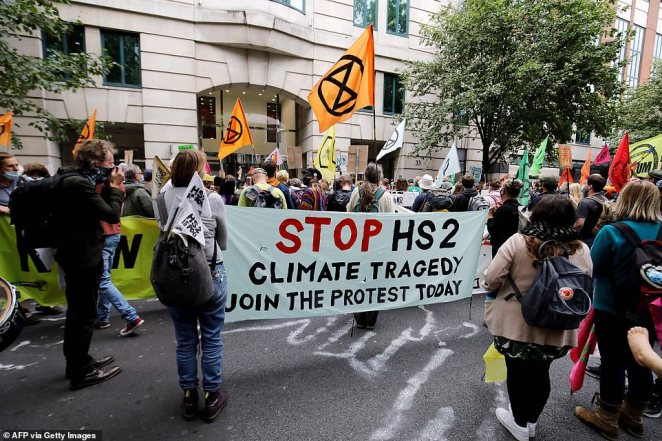 Protesters demonstrate outside the Department of Transport against the HS2 railway as work began on the controversial project yesterday