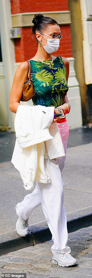 Toned: Showing a hint of a tummy, the beauty strutted towards her car as she carried a small brown shoulder bag