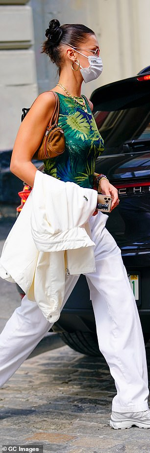 Slicked: The brunette kept her slair slicked back in a high bun as she stepped out of town