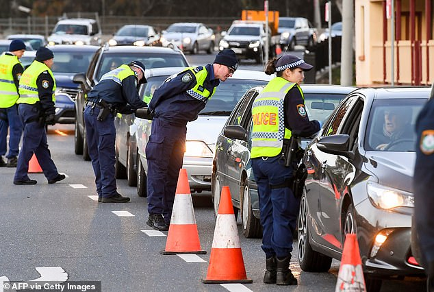 A 66-year-old man has been charged after he allegedly tried to slip border officials $1000 in cash to let him pass through the checkpoint (pictured, checkpoint in Albury on July 8)