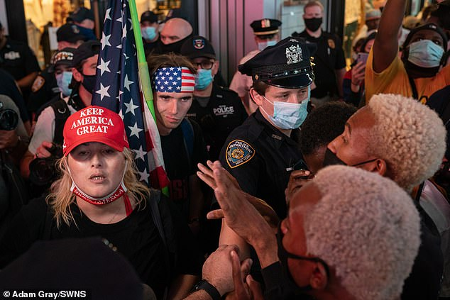 It was later revealed that one of the passengers was transgender pro-Trump activist Juliet Germanotta (in red hat Thursday night). Police had to separate Black Lives Matter supporters and Keep America Great counter-protesters as tensions flared in Times Square