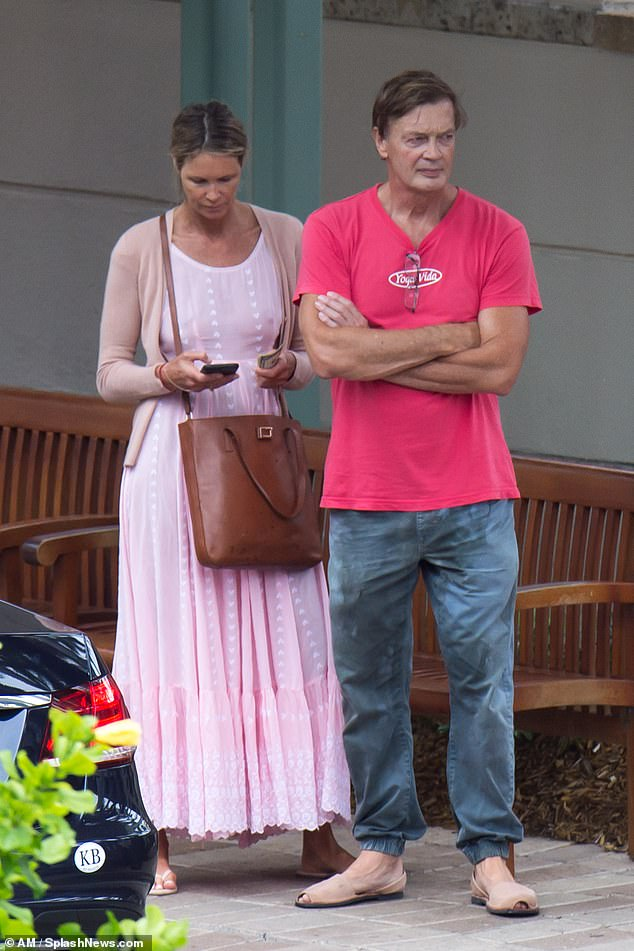 Elle Macpherson is pictured above with Andrew Wakefield in Florida