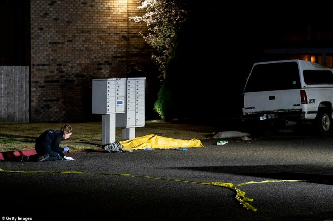 The body of Antifa gunman Michael Reinoehl at the scene in Lacey, Washington where he was shot dead by federal officers in a shootout. Witnesses say he opened fire with a semi automatic rifle