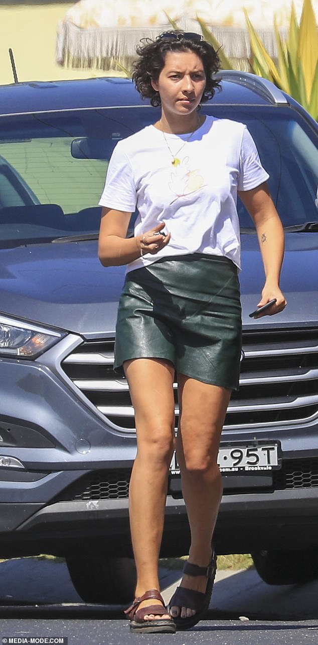 Flashing the pins: Vanessa meanwhile, showed off her trim pins in a leather-look miniskirt and a white printed T-shirt