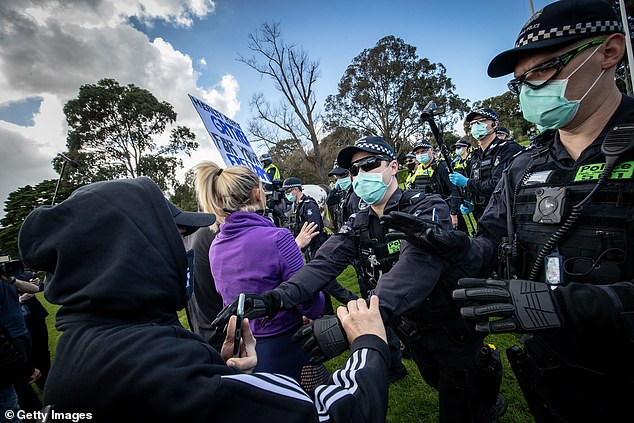 Protest: Vernon joined more than 1,000 anti-lockdown activists at the 'Freedom Day' rally to protest Daniel Andrew's Stage Four lockdown laws