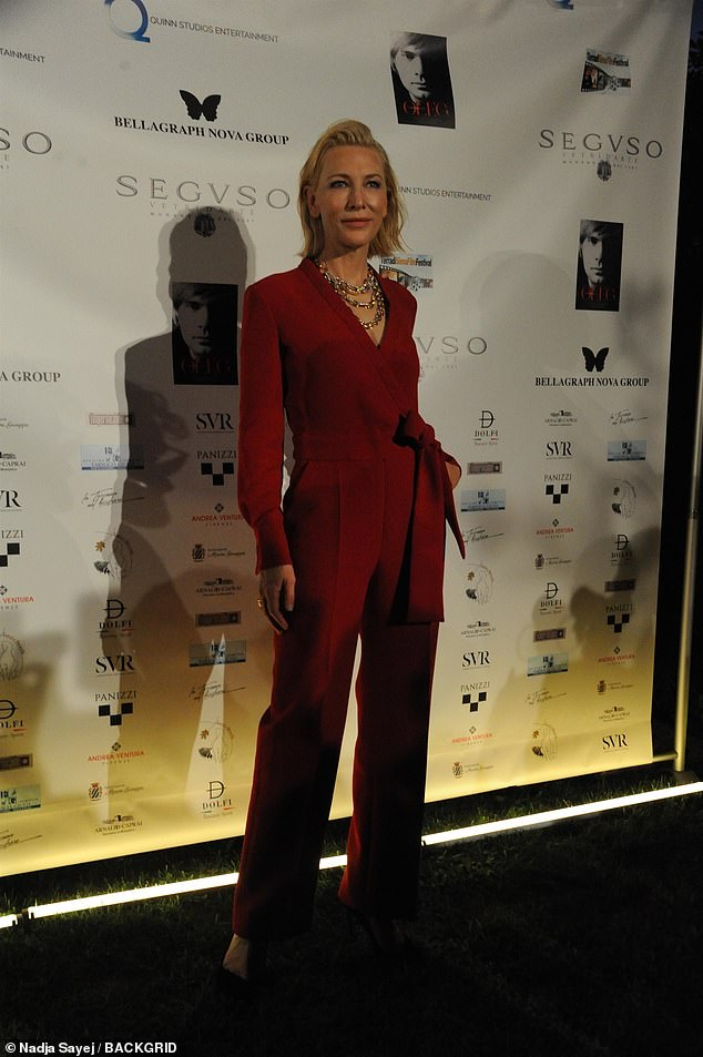 Stunning: Cate Blanchett exuded elegance in a striking red jumpsuit as she received a leadership award in Venice on Friday