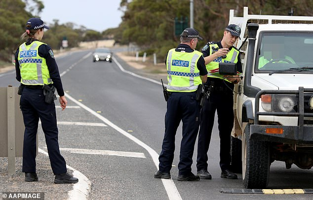 South Australian Police stopping vehicles near the SA border 5kms east of Pinnaroo, South Australia