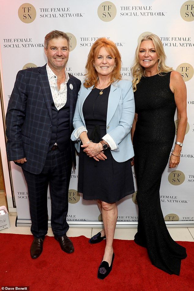 Fiona Bendall, 42, was ordered to pay husband Duncan, 47, after she forced him out of their company The Female Social Network. She is pictured with him and the Duchess of York at the London launch event in June last year