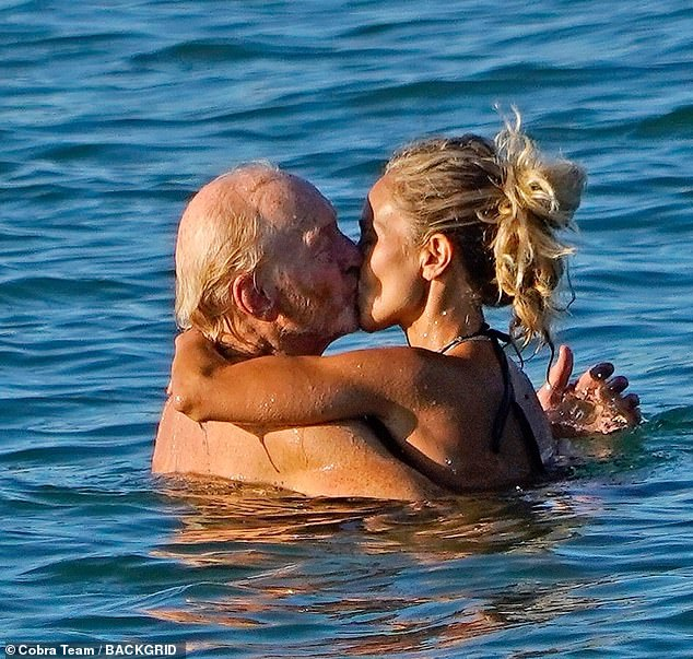 Mwah: Charles went public with his romance with Alessandra on Thursday, as they were pictured passionately kissing in the sea