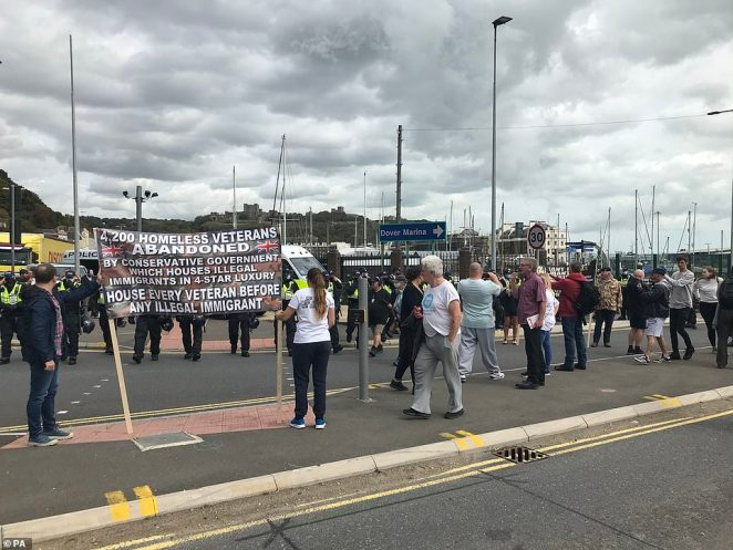 Rival groups have assembled in Dover to demonstrate over the arrival of thousands of migrants in small boats