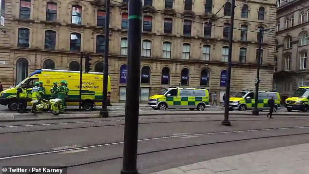 Manchester councillor Pat Karney wrote on Twitter that crowds had 'been pushed back from Piccadilly' while four ambulances were among emergency services in attendance