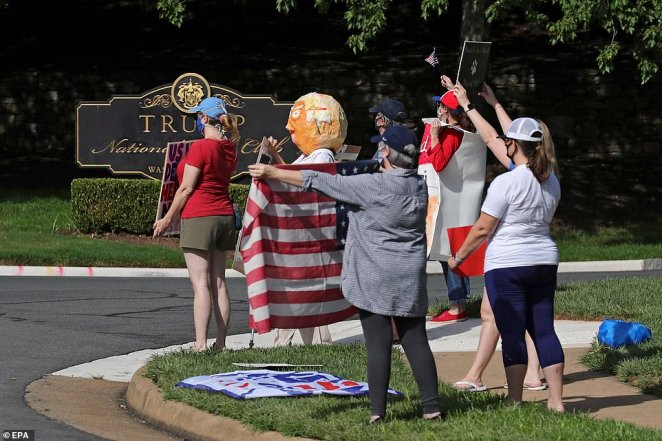 One of the protesters appears to have dressed up as the president near the entrance to the golf club in Sterling, Virginia, on Saturday