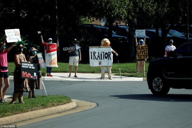 Several protesters greeted Trump's motorcade at the entrance to his golf club in Sterling, Virginia, on Saturday