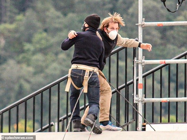 Head-to-head:Tom Cruise, 58, wasn't taking any chances as he prepared to film another heart-stopping scene, as he donned a face mask to practice his latest fight on Saturday