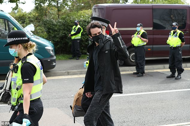 One protester is led away by police outside the Newsprinters printing works at Broxbourne, Hertfordshire following demonstrations (pictured:September 5, 2020)