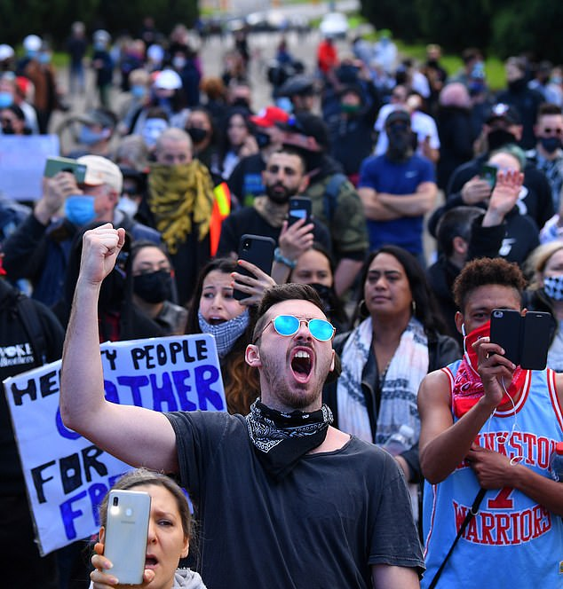 One man is seen shouting for the end of lockdown during the wild protests on Saturday Po