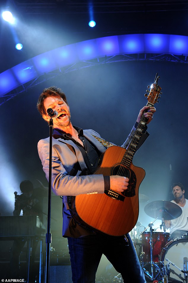 'We are extremely flattered to have been asked to perform at the Gabba AFL GF,' they wrote in a statement shared to their Twitter account on Saturday. Pictured singerBernard Fanning
