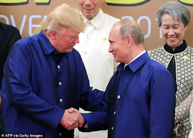 The DOJ Inspector General questioned if Strozk's text messages about Trump (left) were indicative of bias. Pictured: Trump and Putinas they pose for a group photo ahead of the Asia-Pacific Economic Cooperation (APEC) Summit leaders gala dinner in the central Vietnamese city of Danang