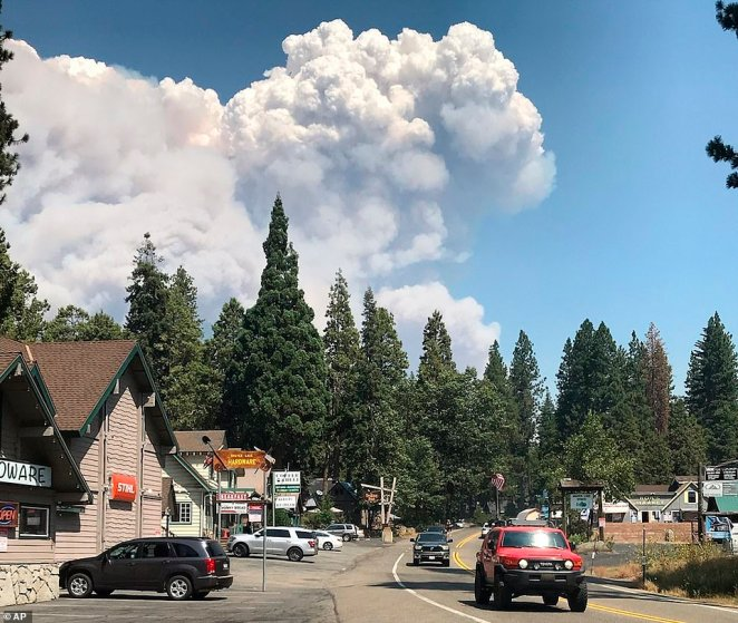 The wildfire burning near Shaver Lake exploded to 56 square miles, jumped a river and compromised the only road into the Mammoth Pool Campground
