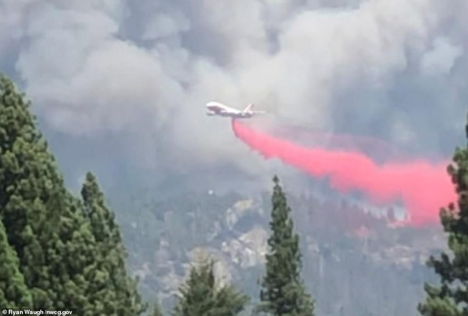 A tanker plane is seen fighting the Creek Fire in California on Saturday