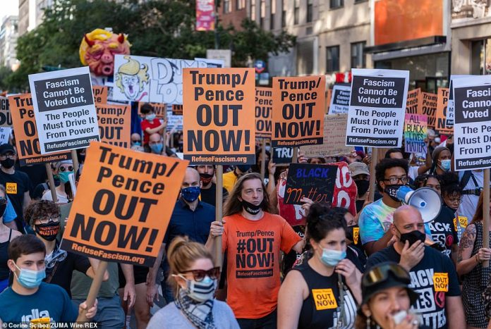 Demonstrators in New York City with the distinctive signs marched through Manhattan on Saturday against Trump