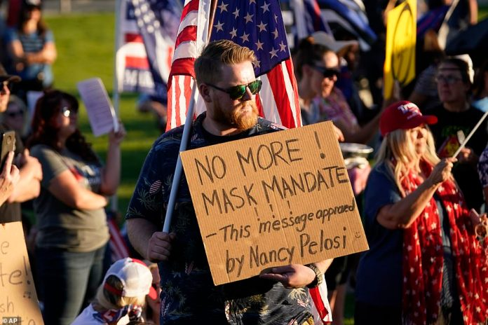 """People gather during a """"Trash Your Mask Protest"""" rally hosted by the Utah Business Revival at the Utah State Capitol Saturday"""