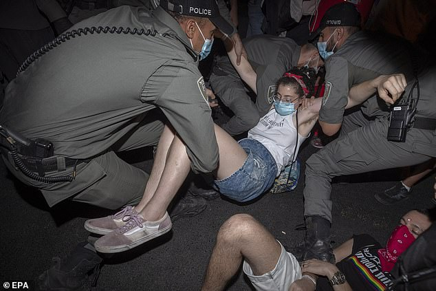Israeli police arrest a protester during the Saturday protest.The protest on Saturday came as Israel copes with record levels of coronavirus infections