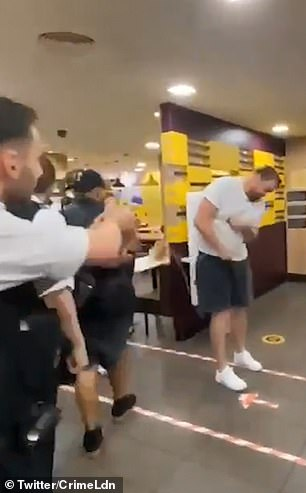 This is the shocking moment a towering reveller barely flinches after he is tasered by police during an altercation in a London McDonald's