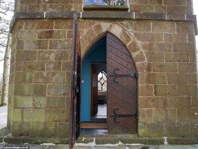 Ornate arched windows provide a view from every floor, whilst the building's heavy wooden door gives a hint of its history (pictured)