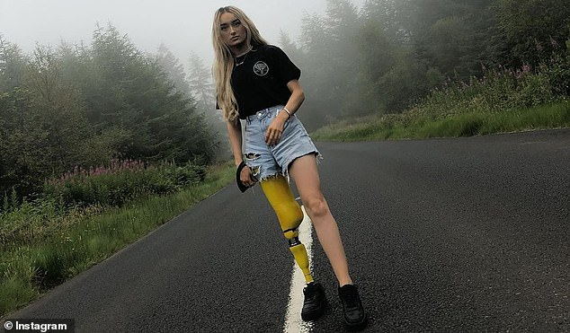 Bernadette began experiencing symptoms of her cancer in August 2017. Pictured: The young woman models her leg, which is this time wrapped in yellow