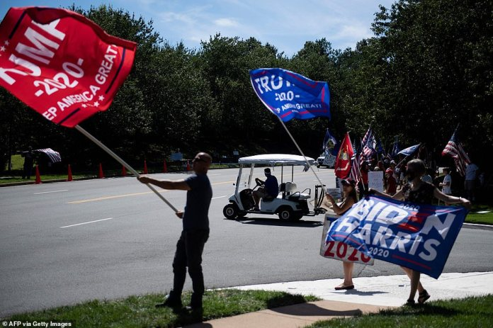 Supporters and critics of the president are pictured by the Trump National Golf Club in Sterling, Virginia, on Saturday