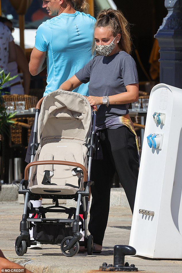 Mother-of-one:The pair looked to be in a sombre mood as they browsed the shops and Chloe pushed a pram