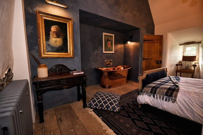 Ted's bedroom - called Speel - features a beautifully upholstered antique double bed and a magnificent copper bath