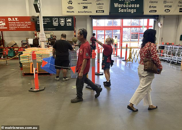 Bunnings staff and customers practice social distancing in the store in Alexandria in March
