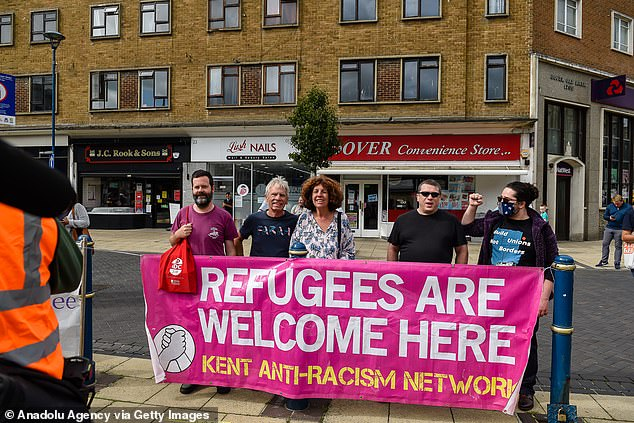 Hundreds of campaigners were confronted by groups of pro-migrant protesters in a counter-demonstration (some demonstrators pictured) following the arrival of 5,600 refugees in small boats this year