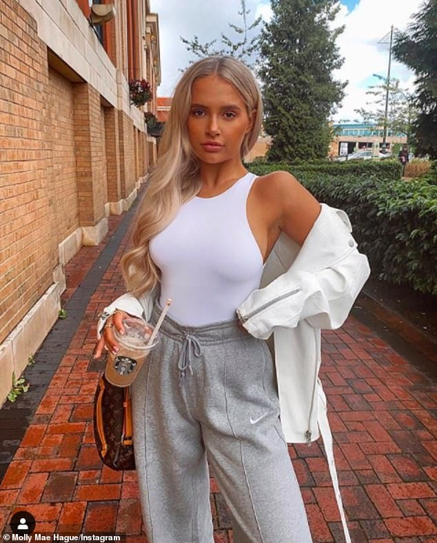 Radiant: Molly-Mae Hague nailed casual chic in a white waistcoat and leather jacket as she headed for a girly shopping spree on Sunday