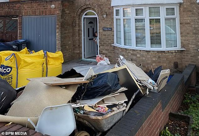 Mr Lewislikens his home of 11-years to a building site, complete with overflowing skip (pictured) and leaky, unfinished roof