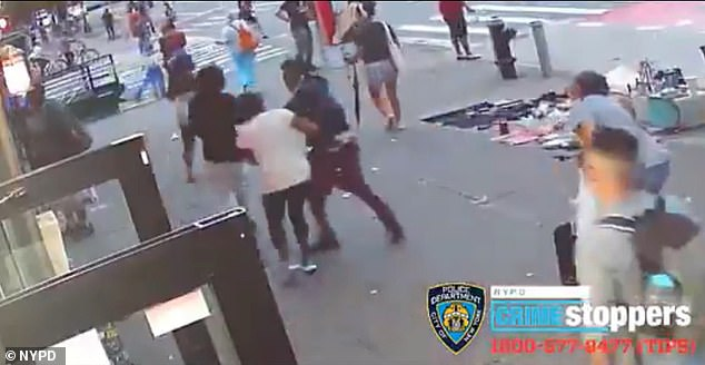 The woman then chases after the group before one boy turns back to punch her, knocking her to the ground