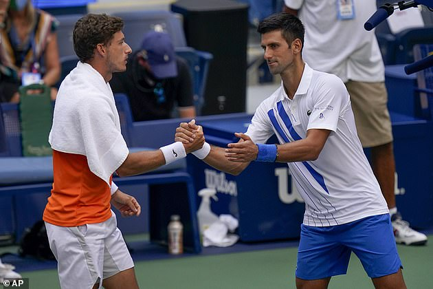 Djokovic protested but then shook hands with Pablo Carreno Busta after defaulting the match