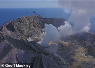A white plume of smoke puffs out of the resting volcano
