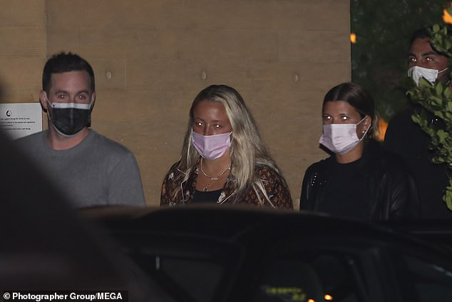 Mask mandate: She made sure to wear a face mask as she collected her car from the valet