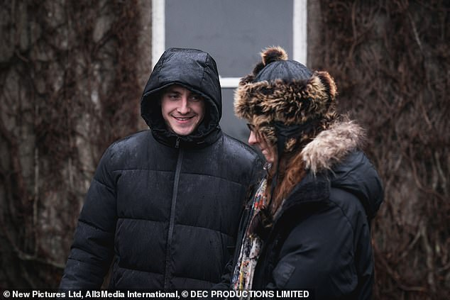 Speak: The star could be seen with her signature cheeky smile despite the shooting conditions as she chatted t