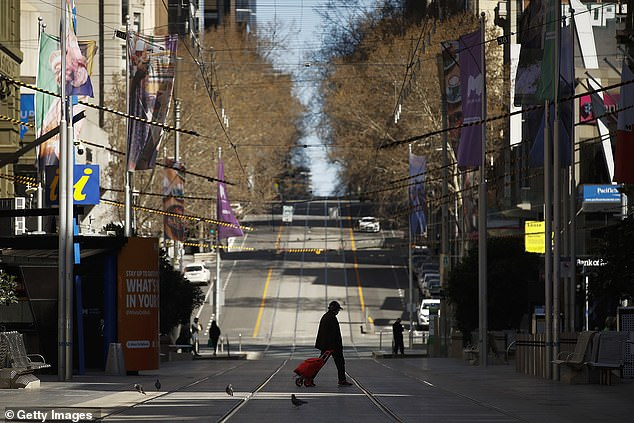 An almost totally deserted Bourke St, Melbourne, at the weekend - as Premier Daniel Andrews announced the city will not be free of lockdown for many weeks to come