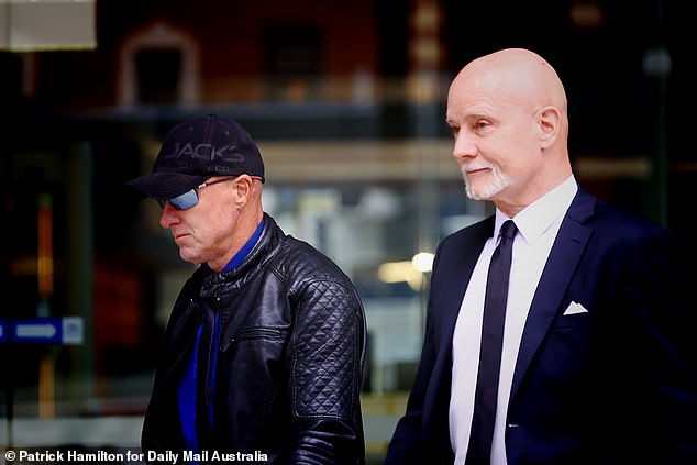 Gilchrist (left with his lawyer, right) was sentenced to three years jail, immediately suspended, on Monday at Brisbane District Court