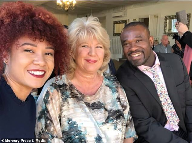 Taylor with mum Michele and dad Melvin who fought in court to allow Taylor to move from the school where she was being bullied due to her race