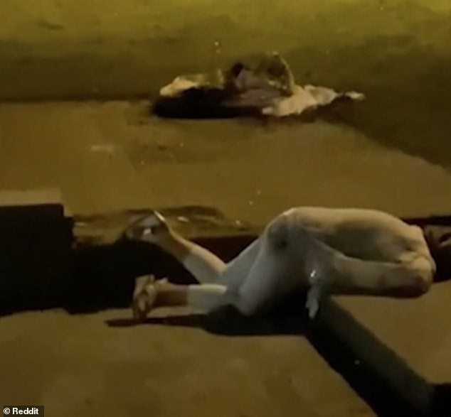 One wedding guest, believed to be a friend of the bride, is seen passed out on the floor after drinking